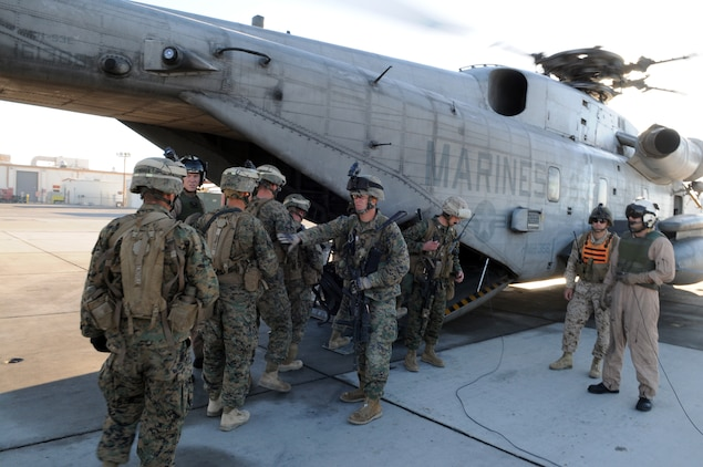 Marines from Company A, 1st Battalion, 2nd Marine Regiment, board a CH-53 helicopter on the flight line at the Marine Corps Air Station in Yuma, Ariz., for a long-distance night helicopter raid exercise Oct. 16, 2009. The company took off from Yuma in six CH-53s and two MV-22 Ospreys to seize an airfield and rescue an enemy defector and his family, as well as retrieve valuable communication equipment, at Fort Huachuca near Tucson, Ariz. The training was in preparation for the battalion's upcoming deployment to Afghanistan in the spring of 2010.
