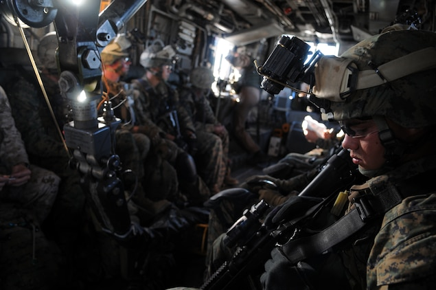 Marines from Company A, 1st Battalion, 2nd Marine Regiment, ride aboard a CH-53 helicopter after taking off from the flight line at the Marine Corps Air Station in Yuma, Ariz., for a long-distance night helicopter raid exercise Oct. 16, 2009. The company took off from Yuma in six CH-53s and two MV-22 Ospreys to seize an airfield and rescue an enemy defector and his family, as well as retrieve valuable communication equipment, at Fort Huachuca near Tucson, Ariz. The training was in preparation for the battalion's upcoming deployment to Afghanistan in the spring of 2010.