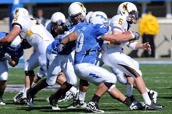 Falcons junior defensive end Rick Ricketts sacks Cowboys quarterback Austyn Carta-Samuels during the Air Force-Wyoming game at Falcon Stadium Oct 17, 2009. Ricketts, a native of San Jose, Calif., had one of the Falcons defense's six sacks on the day. (U.S Air Force photo/Rachel Boettcher)
