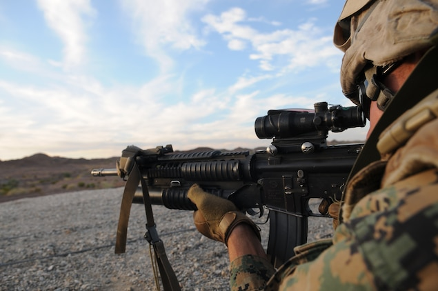 Cpl. Brandon Legendre, a police sergeant with Headquarters and Service Company, 1st Battalion, 2nd Marine Regiment, sights in to fire on a target during infantry tactics training at Graze Range at the U.S. Army Yuma Proving Ground in Arizona, Oct. 18, 2009. Comprised of Marines with noninfantry specialties, the Camp Lejeune, N.C.-based company is preparing to operate as an infantry company during their upcoming deployment to Afghanistan in the spring of 2010.
