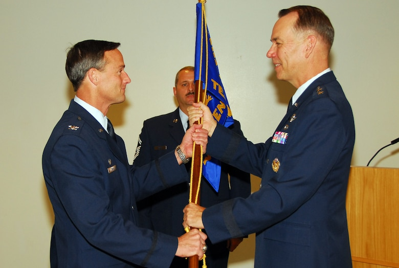 Col. Jon Mott assumes command of the Air National Guard Air Force Reserve Command Test Center with a symbolic passing of the AATC guideon from Maj. Gen. Rick Moisio, Air National Guard deputy director, Oct. 16. (Air National Guard photo by Master Sgt. Dave Neve)