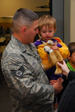 Air National Guardsman Staff. Sgt. Patrick Hakes says goodbye to his son as he prepares to deploy early Monday morning October 19th, 2009 at the Duluth, Minn. Air National Guard Base.  148th Fighter Wing Security Forces personnel are deploying to Southwest Asia in support of Operation Iraqi Freedom.