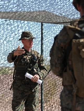 2nd Lt. Daniel Kapcuik, assistant operations officer with Headquarters and Service Company, 1st Battalion, 2nd Marine Regiment, briefs his Marines before infantry tactics training at Graze Range at the U.S. Army Yuma Proving Ground in Arizona, Oct. 18, 2009. Comprised of Marines with noninfantry specialties, the Camp Lejeune, N.C.-based company is preparing to operate as an infantry company during their upcoming deployment to Afghanistan in the spring of 2010.