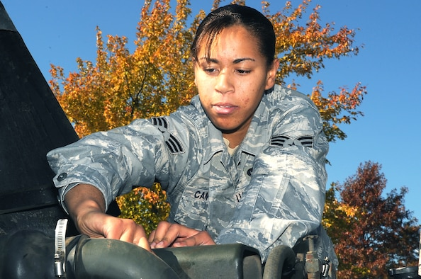 """WHITEMAN AIR FORCE BASE, Mo. -- Senior Airman Kristin Campbell, 509th LRS Vehicle Operator, performs a visual inspection under the hood of a """"deuce and a half,"""" two and a half ton truck.  Operators must inspect their vehicles before each driving assignment. (U.S. Air Force photo / A1C Torey Griffith)"""