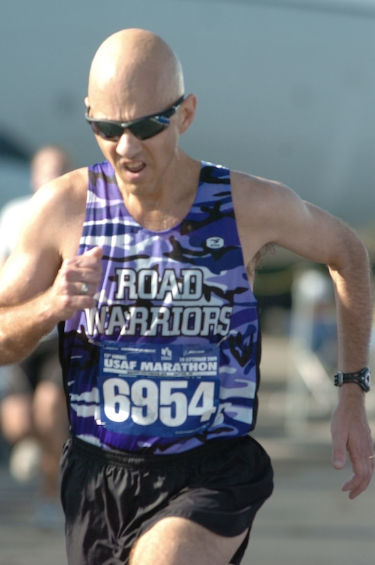 Master Sgt. Mike Sanders runs for the finish line during the Air Force Half Marathon Sept. 19, 2009, at Wright-Patterson Air Force Base, Ohio. Sergeant Sanders ran the event one year and eight months after beating cancer. (Courtesy photo)