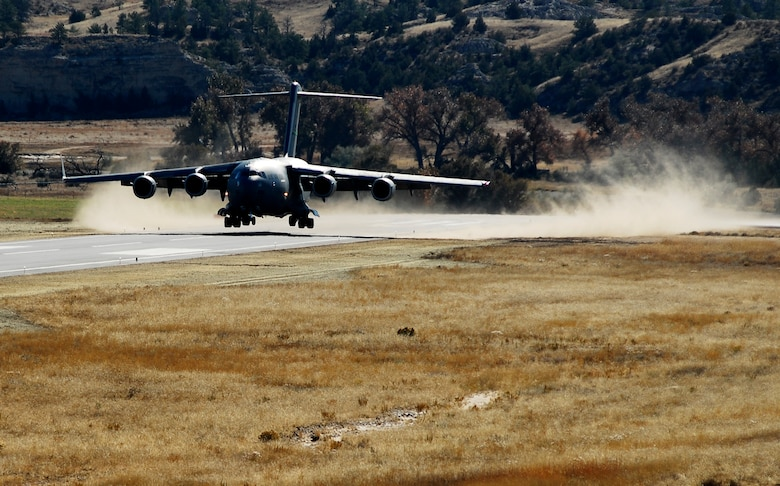 A C-17 Globemaster III aircraft from McChord lands at the Wyoming National Guard's Guernsey Army Airfield at Camp Guernsey in Guernsey, Wyo., during the official opening of an updated airstrip capable of handling the massive cargo aircraft. The airstrip is now capable of supporting up to 20 fixed-wing aircraft as well as three C-17's. In addition to the civilian/military air strip, Camp Guernsey also boasts nearly 70,000 acres of terrain and supports approximately 65 square miles of restricted air space up to 30,000 feet. (Photo by Brandon Quester/Public Affairs Specialist/Wyoming National Guard).