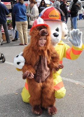 Scott AFB, Ill,; Gabriel Wysong meets Sparky the firefighting dog Saturday at Outdoor recreation's Fall Festival. Sparky promotes fire safety for children.  (U.S. Air Force Photo by Airman 1st Class Tristin English)
