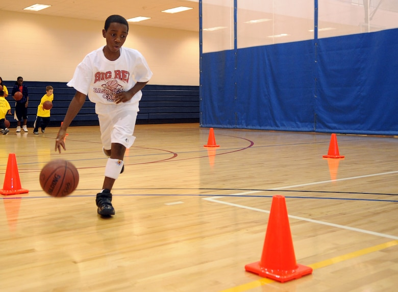 Tayveon Jordan dribbles through a drill during a basketball clinic hosted by the 460th Force Support Squadron at the fitness center Oct. 17. (U.S. Air Force photo by Senior Airman John Easterling)