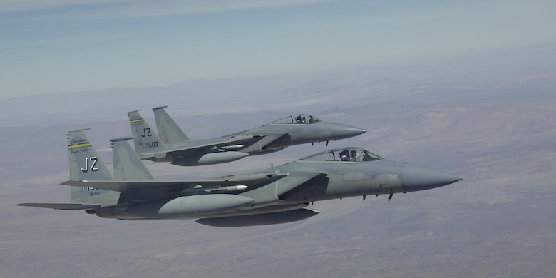 IQUIQUE, Chile – A pair of F-15s with the 159th Fighter Wing fly in a wingtip formation off the wing of a KC-135 Stratotanker during a refueling mission Oct. 22. The Fuerza Aérea de Chile or FACh hosted the United States, Brazil, Argentina, and France during Exercise SALITRE II, a multinational exercise focused on interoperability. (U.S. Air Force photo by Tech. Sgt. Eric Petosky)