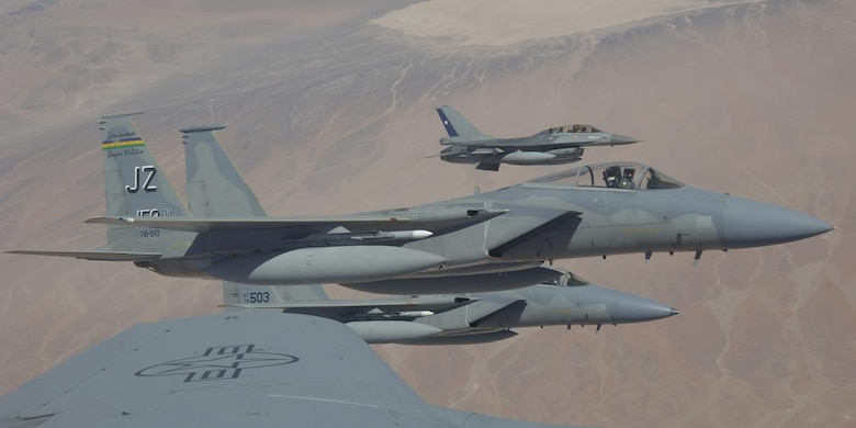 IQUIQUE, Chile – A pair of F-15s with the 159th Fighter Wing, and a Chilean F-16 fly in a wingtip formation off the wing of a KC-135 Stratotanker during a refueling mission Oct. 22. The Fuerza Aérea de Chile or FACh hosted the United States, Brazil, Argentina, and France during Exercise SALITRE II, a multinational exercise focused on interoperability. (U.S. Air Force photo by Tech. Sgt. Eric Petosky)