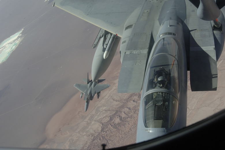 IQUIQUE, Chile – A pair of F-15s with the 159th Fighter Wing receive fuel from a KC-135 Stratotanker during a refueling mission Oct. 22. The Fuerza Aérea de Chile or FACh hosted the United States, Brazil, Argentina, and France during Exercise SALITRE II, a multinational exercise focused on interoperability. (U.S. Air Force photo by Tech. Sgt. Eric Petosky)