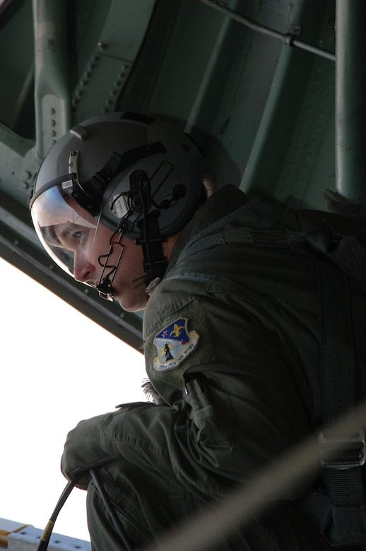 ANTOFAGASTA, Chile – Tech. Sgt. Micah Collins, 159th Fighter Wing loadmaster, watches for the approach of aircraft out the open ramp of a C-130 before a dissimilar aircraft formation at Exercise SALITRE II hosted by Chile. The United State's F-15, Brazil's A-1, Chile's F-16, Argentina's A-4 and France's Mirage flew the formation Oct. 23. (U.S. Air Force photo by Tech. Sgt. Eric Petosky)