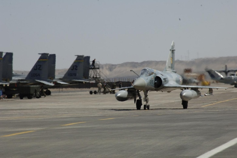 ANTOFAGASTA, Chile – A French Mirage taxis past U.S. F-15s from the 159th Fighter Wing Oct. 23 during Exercise SALITRE II hosted by Chile. (U.S. Air Force photo by Tech. Sgt. Eric Petosky)