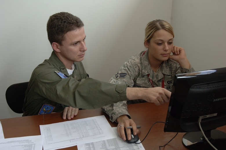 ANTOFAGASTA, Chile -- Capt. Diogo (left) of the Brazilian Air Force, and Senior Airman Jessica Bartholomew, 612th Air Operations Center, Combat Plans Division, ATO production technician, learn to use Fuerza Aérea de Chile or FACH equipment during the opening days of SALITRE, a multinational exercise sponsored by Chile to promote interoperability. Chile, Brazil, France, Argentina and the United States are participating in the exercise. (U.S. Air Force photo by Tech. Sgt. Eric Petosky)