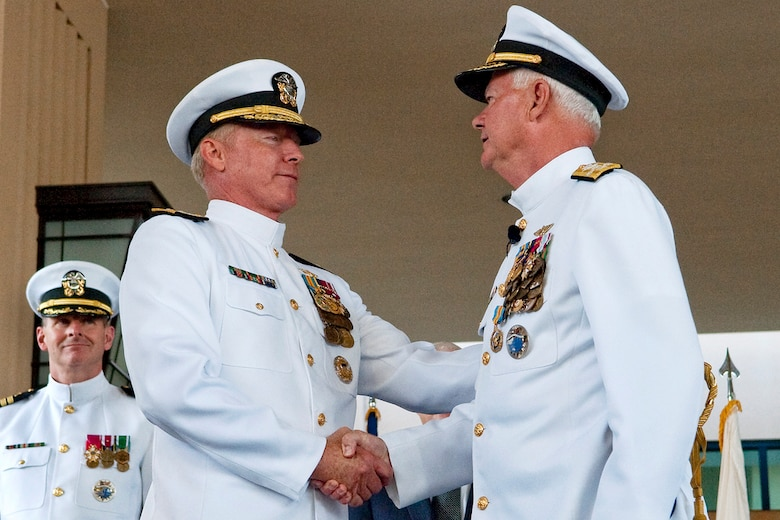 091019-N-0696M-269 U.S. Navy Adm. Timothy Keating, is relieved of duty by U.S. Navy Adm. Robert F. Willard at the PACOM change-of-command ceremony, Camp Smith, Hawaii, Oct. 19, 2009. (DoD photo by Mass Communication Specialist 1st Class Chad J. McNeeley/Released)