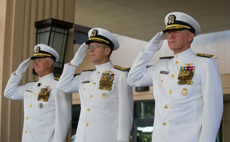 Adm. Robert F. Willard (from right), incoming commander of U.S. Pacific Command; Adm. Mike Mullen, chairman of the Joint Chiefs of Staff; and Adm. Timothy J. Keating, outgoing commander of U.S. PaCom, render honors during the singing of the national anthem at the U.S. PaCom change of command ceremony Oct. 19, 2009, at Camp H.M. Smith, Hawaii. Admiral Willard, former U.S. Pacific Fleet commander, assumed command of U.S. PaCom from Admiral Keating during the ceremony.  (U.S. Navy photo/Navy Petty Officer 2nd Class Elisia V Gonzales)