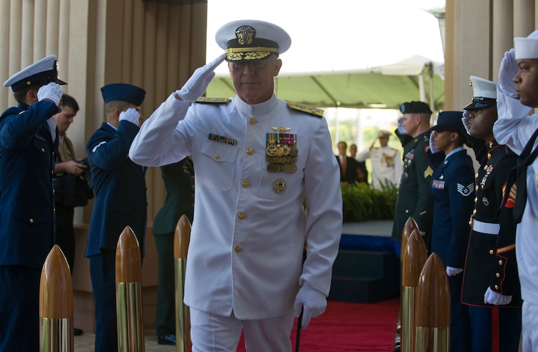 Adm. Robert F. Willard, incoming commander of U.S. Pacific Command, renders a salute as he passes through side boys during the U.S. PaCom change of command ceremony Oct. 19, 2009, at Camp H.M. Smith, Hawaii. Admiral Willard, former U.S. Pacific Fleet commander, assumed command of U.S. PaCom from Adm. Timothy J. Keating during the ceremony. (U.S. Navy photo/Navy Petty Officer 2nd Class Elisia V Gonzales)