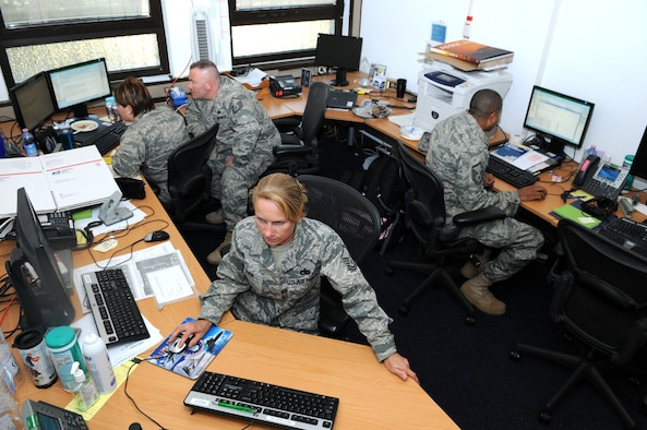 RAMSTEIN AIR BASE, Germany -- (Clockwise from right) Master Sgt. Shaun Ford, Master Sgt. Susan Cook, Capt. Amanda Sater and Master Sgt. Rich Rizzo of 17th Air Force's A4/7 (Logistics) Directorate share a small work space due to ongoing construction and the growing size of the staff. Ten workstations have been improvised in the 248-square foot room. (USAFE photo by Master Sgt. Jim Fisher)