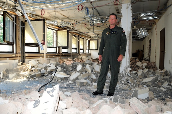 RAMSTEIN AIR BASE, Germany -- Col. Andy Redmond, commander of the 617th Air and Space Operations Center surveys the construction Sept. 10, in what will become the new AOC. Seven walls were demolished in Building 413 to accommodate the new facility, which includes a watch cell. The building also serves as headquarters for 17th Air Force, the 617th's parent organization and the air component for U.S. Africa Command. All Air Force flying activity in Africa will be overseen from the new AOC and watch cell. (USAF photo by Master Sgt. Jim Fisher)