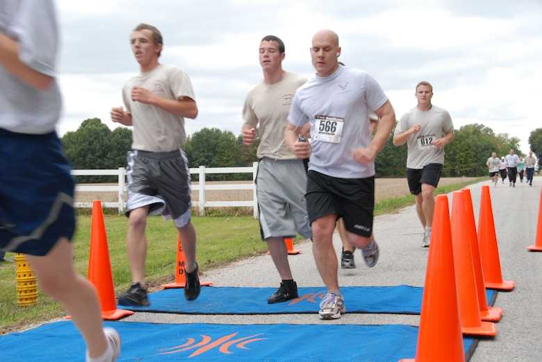 Unit members push hard to get their best time on the 1.5 mile Fun Run.  Photo by TSgt Michael Kellams