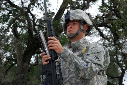 FORT SAM HOUSTON, Texas — Spc. Carlos Morales, 1st Battalion, 228th Aviation Regiment, U.S. Army South, assembles an M-16 rifle during the U.S. Army South Soldier of the Quarter competition here. (Photo by Robert R. Ramon, U.S. Army South Public Affairs)