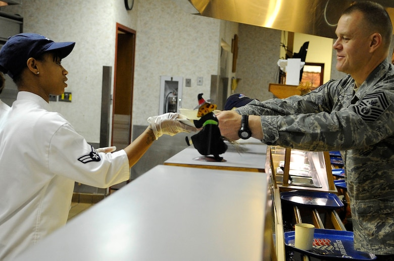 Airman 1st Class Tiara Taylor, 28th Force Support Squadron food services journeyman, hands breakfast to Chief Master Sgt. of the Air Force James A. Roy, Oct. 22, 2009, during his two-day visit to Ellsworth Air Force Base, S.D.  Chief Roy ate breakfast with recent graduates of Airmen Leadership School and discussed various high-interest Air Force topics.  (U.S. Air Force photo/Airman 1st Class Corey Hook)
