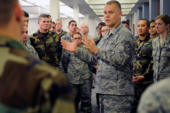 Chief Master Sgt. of the Air Force James A. Roy talks with Airmen and civilians at the financial services center, Oct. 21, 2009, during a two-day visit to Ellsworth Air Force Base, S.D.  Chief Roy discussed the importance of their finance and travel work to the Air Force during his visit. (U.S. Air Force photo/Airman 1st Class Corey Hook)