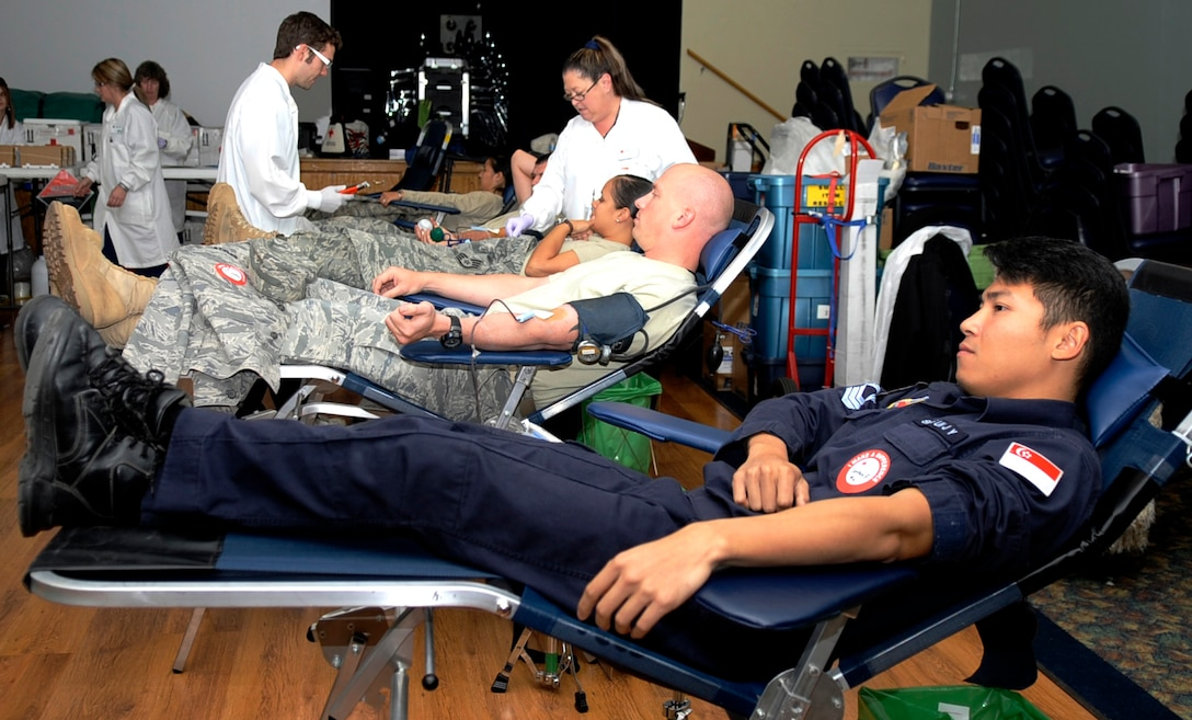 MOUNTAIN HOME AIR FORCE BASE, Idaho -- Gunfighters and members of the Republic of Singapore air force donate blood Oct. 22 at the Community Center. The 366th Fighter Wing collected 121 units of blood, beating the previous record of blood donated in one day by eight units. (U.S. Air Force photo by Senior Airman Samantha Crane)