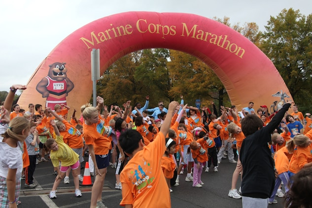 Participants in the Healthy Kids Fun Run warm up before setting off on their one-mile run in Arlington, Va., Oct. 24. About 4,000 children, ages 6 to 13, braved the cold and rain to participate in the run. The event has been a prelude to the Marine Corps Marathon for eight years.