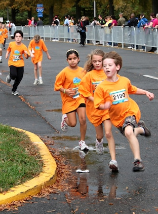 Runners head toward the finish line of the Healthy Kids Fun Run in Arlington, Va., Oct. 24.