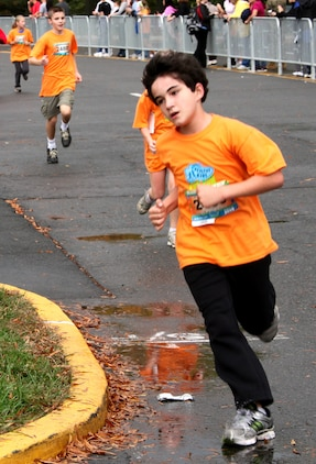 Max Griffon, 11, from Champaign, Ill., runs around the final corner of the Healthy Kids Fun Run in Arlington, Va., Oct. 24.