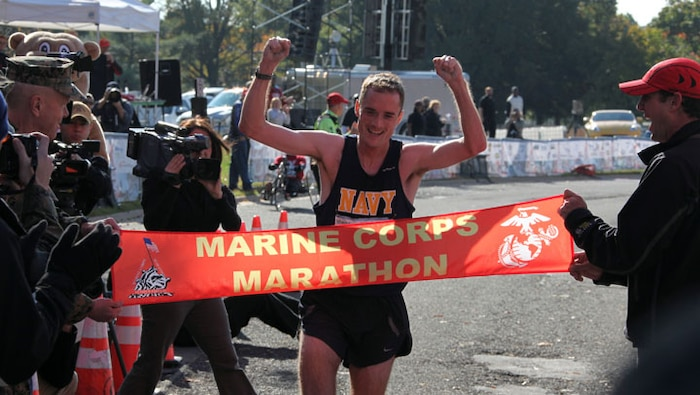 The first finisher of the 34th Marine Corps Marathon was Lt. Cmdr. John Mentzer, 33, of Portsmouth Naval Shipyard, Maine with a time of 2:21:47. Nearly 21,000 runners crossed the start line at today's Marine Corps Marathon. The 26.2 mile race took participants on a journey through the streets of Arlington, Va., and Washington, D.C. culminating with a finish at the Marine Corps War Memorial.