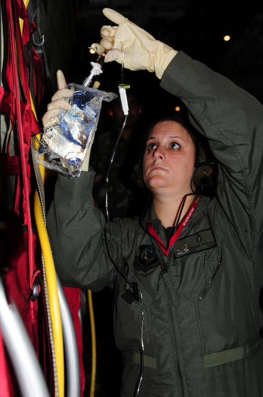 Tech. Sgt. Melissa Worley,   an independent duty medical technician from the 353rd Operations Squadron at Kadena Air Base, Japan, prepares a saline solution for a mock patient during a casualty evacuation exercise at Air Force Station Agra, India, Oct. 24. Cope India is a United States and India airlift exercise that provides training for humanitarian assistance and disaster relief operations. (U.S. Air Force photo/Capt. Genieve David)