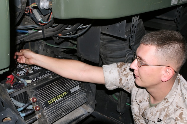 Corporal Jason Rex, a modifications noncommissioned officer with Combat Logistics Company 23, makes repairs to a street sweeper Monday. Along with taking care of its primary mission aboard the Air Station, CLC-23 Marines also volunteer throughout the Lowcountry area for schools and for Marine Corps Community Services functions.
