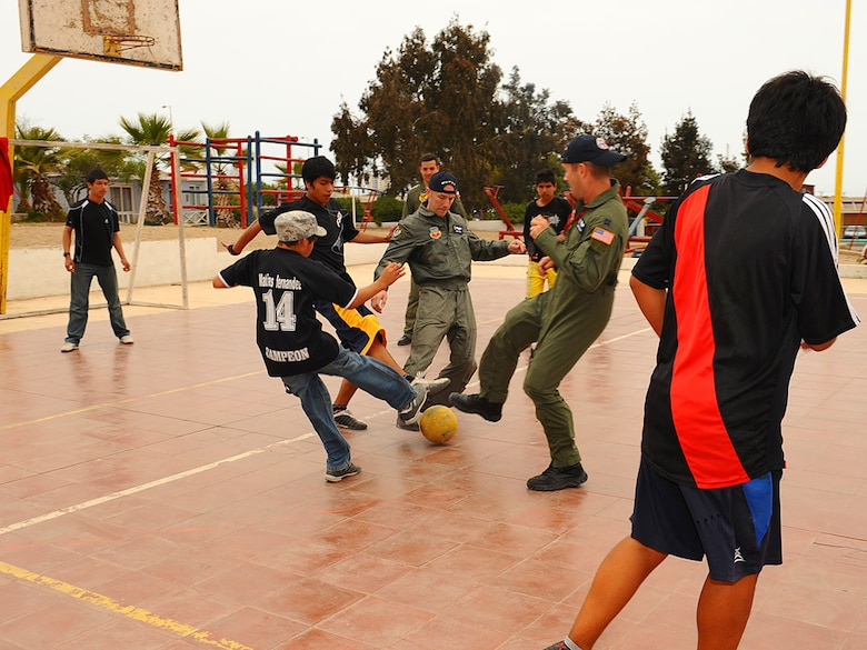 Members of the 71st Rescue Squadron play soccer with children at the Aldeas SOS orphanage in Antofagasta, Chile on Sunday.  The aircrew was part of a more than 40 person team of US, Chilean and Argentine Air Force members who visited the home for orphaned and abandoned children while taking time off from exercise SALITRE, a five-nation event focused on coalition interoperability during peacekeeping operations. (U.S. Air Force photo by Master Sgt. Daniel Farrell)