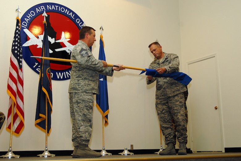 Lt Col William Michell, the last Commander of the 189th Airlift Squadron, encases the unit's flag for the last time symbolizing the official deactivation of the 189th. Holding the staff is Chief Master Sgt Wayne Slappey. The 189th operated C-130 Hercules transport aircraft from October 1996 until it's final flight and stand down on July 2009. (Air Force photo by Staff Sgt Heather Walsh)(Released)
