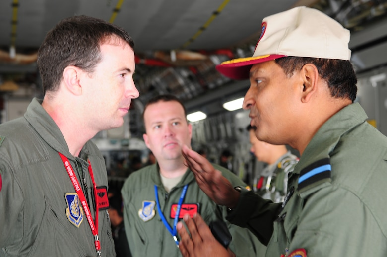 Indian air force Air Commodore Shouvik Roy asks questions of Maj. Sean Papworth, 535th Airlift Squadron, Hickam Air Force Base, Hawaii, during pre-flight discussion of the mission. Commodore Roy was an observer during one of the last sorties for Cope India. Cope India is a United States and India airlift exercise that provides training for humanitarian assistance and disaster relief operations. (U.S. Air Force photo/ Capt. Genieve David)