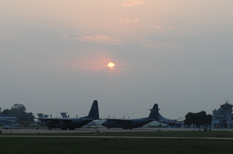 Two C-130 Hercules rest after a long day of missions during exercise Cope India at Air Force Station Agra, India. Cope India is a United States and India airlift exercise that provides training for humanitarian assistance and disaster relief operations. (U.S. Air Force photo/Capt. Genieve David)
