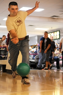 A member of Team Little Rock slings his bowling ball down the lane in hopes of a strike during the base's Combined Federal Campaign bowling tournament fundraiser at the base bowling alley Oct. 23. The CFC fundraising campaign is from Oct. 13 through Nov. 20. (U.S. Air Force Photo by Senior Airman Jim Araos)