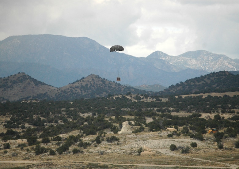 A simulated container delivery system falls to Earth Sept. 24 after an Air Force Reserve C-130 Hercules assigned to the 302nd Airlift Wing air dropped it over Fort Carson, Colo. The drop was in support of the U.S. Air Force Academy's Airdrop Enhanced Logistics Visibility System prototype system that demonstrated the ability of commanders in the field and at the headquarters level to simultaneously identify the location and contents of a CDS within minutes of the cargo leaving the aircraft. The AELVIS program aims to provide war fighters in locations like Iraq and Afghanistan with exact details on crucial cargo drops for resupply. (U.S. Air Force photo/Capt. Jody L. Ritchie)