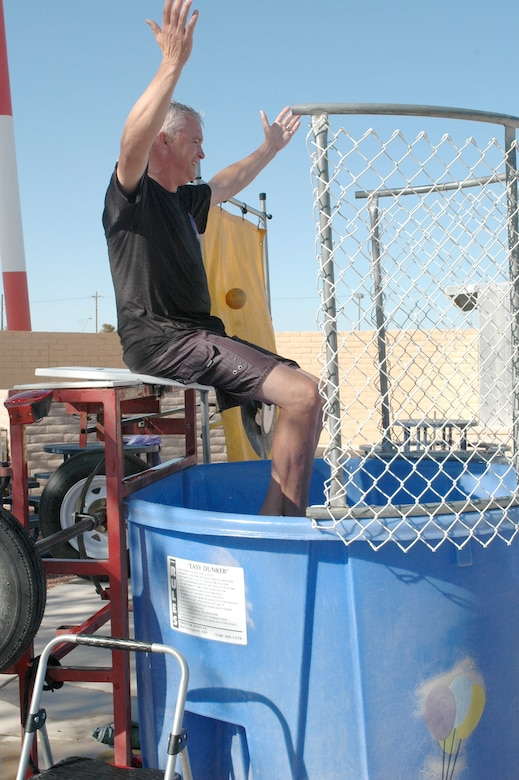 Col. Ted Maxwell, 162nd Fighter Wing vice commander, waits to be dropped into a dunk tank during the 162nd Fighter Wing's Haunted Hangar, Oct. 25. Several wing leaders volunteered for the tank to raise funds for the Family Readiness Group. (Air National Guard photo by Maj. Gabe Johnson)