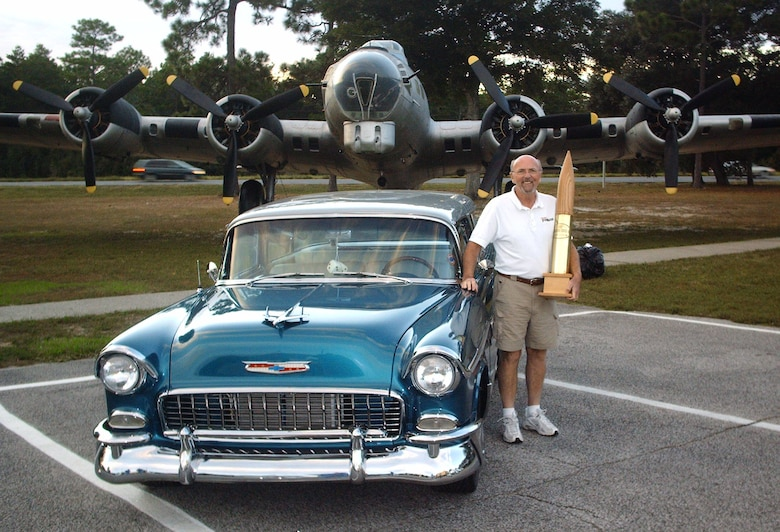 Roger Perman, a native of Destin, Fla., won Overall Best in Show with his 1955 Chevrolet Nomad at the 2009 Commando Cruise-In at the Air Force Armament Museum Oct. 24.  Mr. Perman said he was ecstatic about winning after maintaining the car for two years.  His prize included $150 and a specialized 105mm shell trophy.  (U.S. Air Force photo by Airman 1st Class Joe McFadden.)