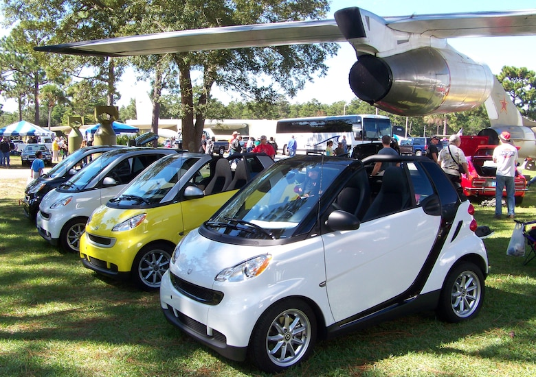 A collection of European Smart cars sit on display under the wing of an F-101 at the 2009 Commando Cruise-In at the Air Force Armament Museum Oct. 24. The cars were entered in different categories including size and country of origin. (U.S. Air Force photo by Airman 1st Class Joe McFadden.)