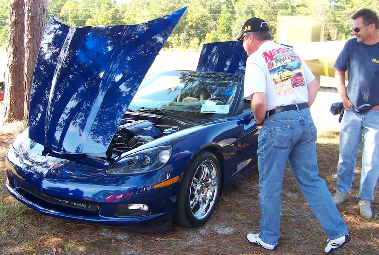 Two men check out a Chevrolet Corvette at the 2009 Commando Cruise-In at the Air Force Armament Museum Oct. 24. The Corvette was one of many muscle cars on display at the car show. (U.S. Air Force photo by Airman 1st Class Joe McFadden.)