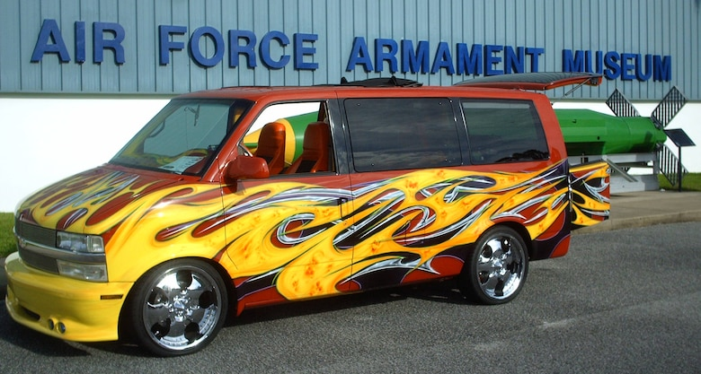 A Chevrolet Astro van with a flame paint job is parked outside the Air Force Armament Museum for the 2009 Commando Cruise-In Oct. 24. The van was one of many types of vehicles to enter the show for style and quality. (U.S. Air Force photo by Airman 1st Class Joe McFadden.)