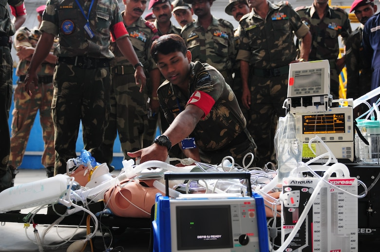 An Indian Air Force medic provides emergency response on a mannequin patient during a U.S. Air Force medical demonstration as part of exercise Cope India. Cope India is humanitarian assistance disaster relief exercise scheduled Oct. 19-23. (U.S. Air Force photo/Capt. Genieve David)
