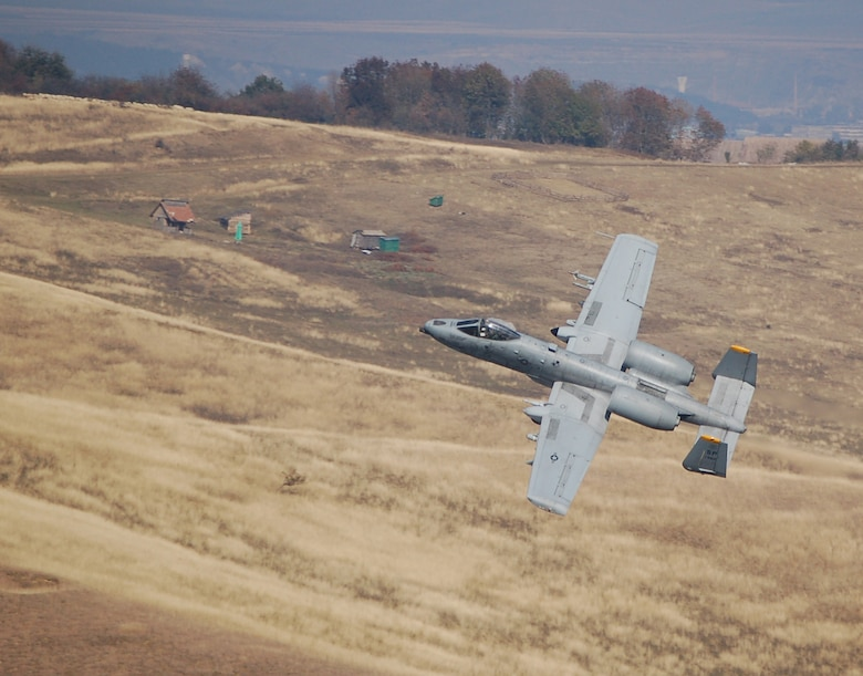 "CAMPIA-TURZII, Romania -- An 81st Fighter Ssquadron pilot prepares to shoot the A-10 Thunderbolt II's 30 mm seven-barrel Gatling gun during training at a range here Oct. 22. Precise weapons delivery is one of the 81st FS' priorities while training here, as pilots are able to utilize many of the A-10s capabilities. ""This deployment offers tremendous training opportunities for an A-10 squadron,"" said Lt. Col. Ronald Stuewe, 81st FS commander. ""We plan on maximizing the events that are difficult to obtain from home station – low altitude, chaff and flare employment, and basic weapons delivery.  The potential ability to utilize our Data-Link (a computer network for communication between aircraft) will be critical in the European Command Area of Responsibility and will truly allow the squadron to train like we fight."" (U.S. Air Force photo/2nd Lt. Kathleen Polesnak)"