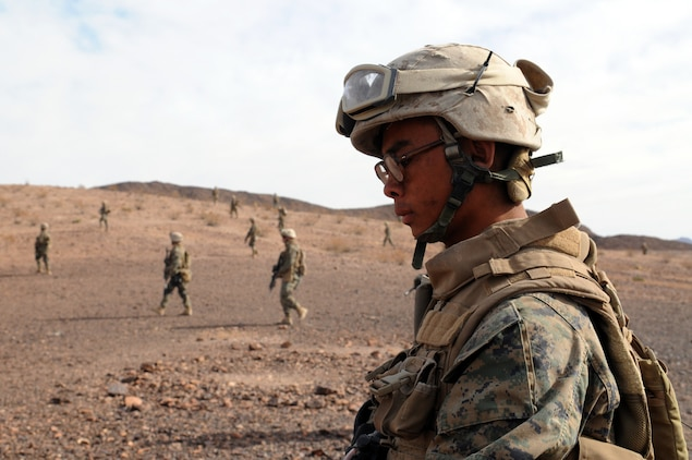 Pfc. William Lim, a machine gunner with Company C, 1st Battalion, 2nd Marine Regiment, advances toward targets in the opening minutes of a company-sized exercise at the U.S. Army Yuma Proving Ground in Arizona, Oct. 27, 2009. The Camp Lejeune, N.C.-based battalion spent approximately one month the Yuma area, making use of its surroundings' rocky, mountainous terrain in preparation for a deployment to Afghanistan early next year. The exercise stressed the approximately 220-Marine force to use combined arms, ranging from rifles and machine guns to mortars and TOW missiles. Lim, 20, is a native of New York City.