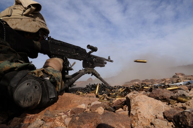 An M-240B machine gun spews spent casings as Pfc. Nathan McBride, a machine gunner with Company C, 1st Battalion, 2nd Marine Regiment, lays down suppressive fire during a company-sized exercise at the U.S. Army Yuma Proving Ground in Arizona, Oct. 27, 2009. The Camp Lejeune, N.C.-based battalion spent approximately one month the Yuma area, making use of its surroundings' rocky, mountainous terrain in preparation for a deployment to Afghanistan early next year. The exercise stressed the approximately 220-Marine force to use combined arms tactics, ranging from rifles and machine guns to mortars and TOW missiles. McBride, 20, is a Cincinnati-native.