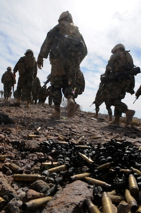 Spent casings litter the ground as Marines from Company C, 1st Battalion, 2nd Marine Regiment, make their way off a training range after a company-sized exercise at the U.S. Army Yuma Proving Ground in Arizona, Oct. 27, 2009. The Camp Lejeune, N.C.-based battalion spent approximately one month the Yuma area, making use of its surroundings' rocky, mountainous terrain in preparation for a deployment to Afghanistan early next year. The exercise stressed the approximately 220-Marine force to use combined arms tactics, ranging from rifles and machine guns to mortars and TOW missiles.